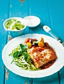 Fish fillet with tomato & olive sauce and courgette spaghetti