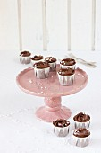 Chocolate cupcakes on a two-tier cake stand