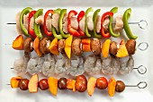 Assorted skewers for the barbecue (seen from above)