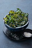 Kale crisps with sea salt in a bowl