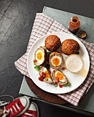 Scotch eggs with hot sauce