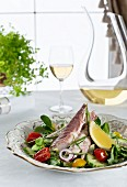 Salad with smoked trout, lemon and herbs
