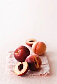 Fresh nectarines, whole and halved