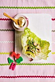 Lettuce wraps with chicken, avocado, spring onion, cucumber and mayonnaise