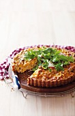 A quiche with sweetcorn, tuna, cheese, rocket and coriander