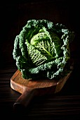 Savoy cabbage on a chopping board