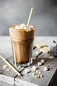 A glass of iced coffee with white chocolate and marshmallows