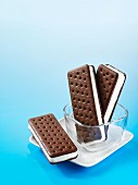 Ice cream sandwiches in a glass dish and on a plate