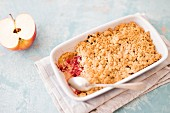 Apple & raspberry crumble in a casserole dish