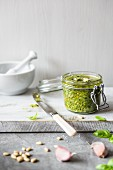 A jar of home-made basil pesto with pine nuts, basil, garlic and Parmesan