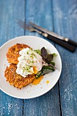 Sweet potato fritters with egg and sesame seeds