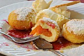 Apricot dumplings with vanilla ice cream (close-up)