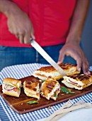 Braai broodjie (South African toasted baguettes) with tomato, onion and mozzerella
