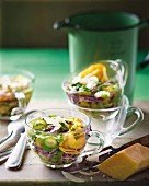 Minestrone with spring vegetables and tortellini in glass cups