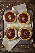 Chocolate & budino tartlets with olive oil and sea salt