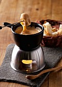 Cheese fondue with bread cubes