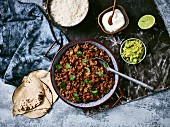 Chili con carne with rice, guacamole, sour cream and tortilla