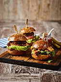 Pulled pork sliders on a wooden board