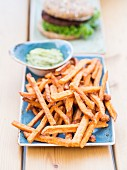 Sweet potato chips with avocado purée