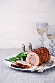 Rolled pork roast with green beans
