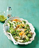 A vegetable salad full of vitamins with peas, avocado, cucumber and chicken