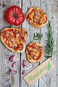 Pizza with tomato, garlic and rosemary