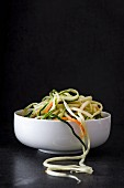 Carrot and courgette noodles in a bowl