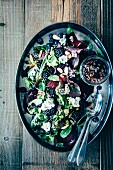 Leaf salad with blueberries, blackberries, beetroot, edible flowers, roasted almonds and red wine vinegar & onion vinaigrette