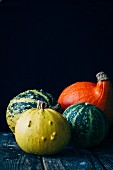 Assorted pumpkin varieties on a wooden table