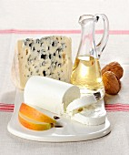A cheeseboard with goats' cheese and blue cheeae