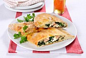Mezzaluna con spinaci (Italian pastry pockets with a spinach filling)