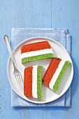 Three-coloured terrine with tomatoes, cream cheese and green peas