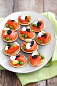 Blini with smoked salmon, caviar, sour cream and peas