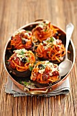 Baked portobello mushrooms filled with spaghetti, chorizo, black olives and tomatoes