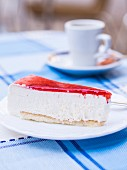 A slice of cold cheesecake with a strawberry topping