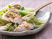 Asian chicken salad with chilli and sesame seeds