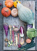 Assorted winter vegetables on a wooden board
