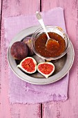 Fig jam in a bowl with a spoon