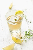 Home-made thyme syrup lemonade with lemon