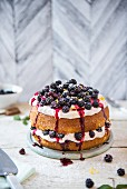 Blackberry & lemon cake with cream and blackberry sauce
