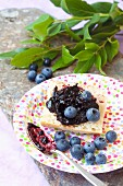 Bread with blueberry jam and fresh blueberries