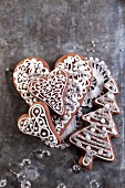 Christmas gingerbread Christmas tree and heart biscuits on a lace doily