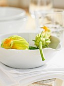 Courgette flowers in a white bowl