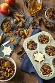 Unbaked mince pies with ingredients for Christmas