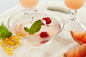 Paloma cocktail with grapefruit, raspberries, mint and ice