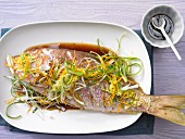 Red snapper with spring onions and orange