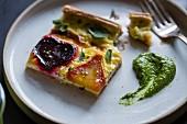 Beetroot ricotta cheese tart with beet greens pesto