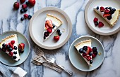 Sliced No-Bake Lemon Berry Coconut Cream Tart with fresh berries (vegan, gluten-free, refined sugar-free) on plates