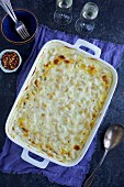 Macaroni and cheese with artichokes in a baking dish