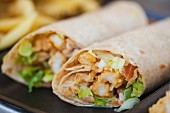 Two wraps with fried calamari and lettuce